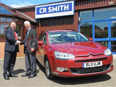 CR Smith Fleet Manager, Ian Darroch Takes Delivery of The Citroen C5 From Citroen's Richard Petherick