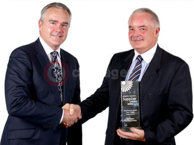 Ford Britain Managing Director Nigel Sharp With Motability Award Received From BBC's Huw Edwards
