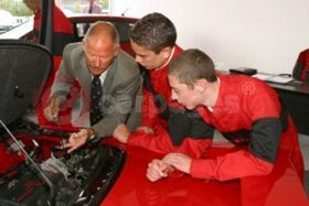Two pupils from Richard Hale School Hertfordshire with deputy headmaster Steve Neate study the inner workings of Honda's NSX sports car as part of the IMI-developed motor vehicle Pre Apprentice programme.