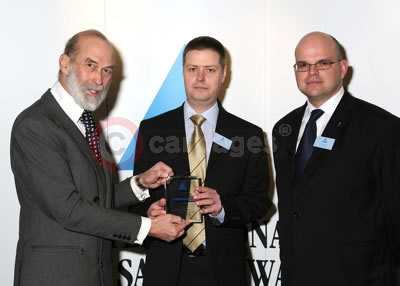 His Royal Highness Prince Michael of Kent presents award to Jonathan Mabey (centre) and Bill McLundie from Jaguar Vehicle Safety