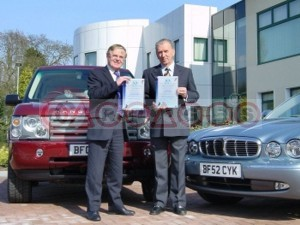 Bob Dover, Chairman and CEO of Jaguar and Land Rover Accepts Certificates From Derek Harvey, Chief Executive, VCA