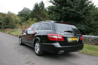 Mercedes Benz E300 BlueTEC Hybrid (Rear Side View) (2012)