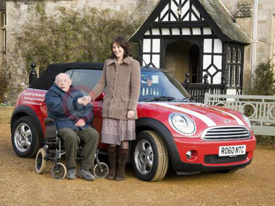 Lord Montagu With MINI Raffle Winner Mrs Helen Dacey and The MINI One Convertible