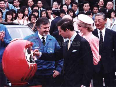The Painting of The Japanese Daruma Doll's First Eye By Prince Charles and Princess Diana